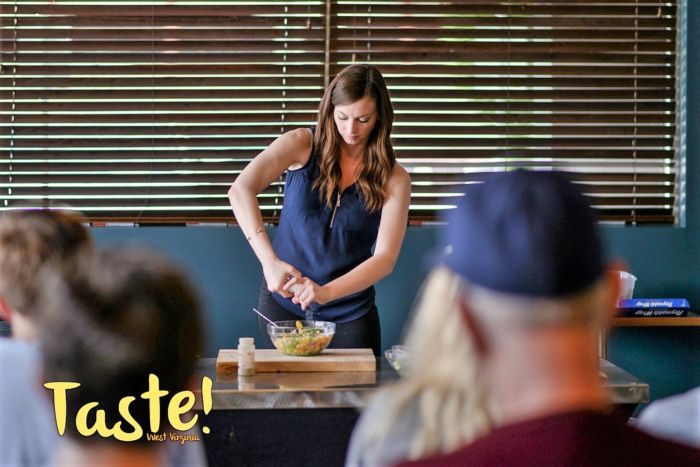Brittany Furbee giving a cooking demonstration at Taste-of-All Charleston